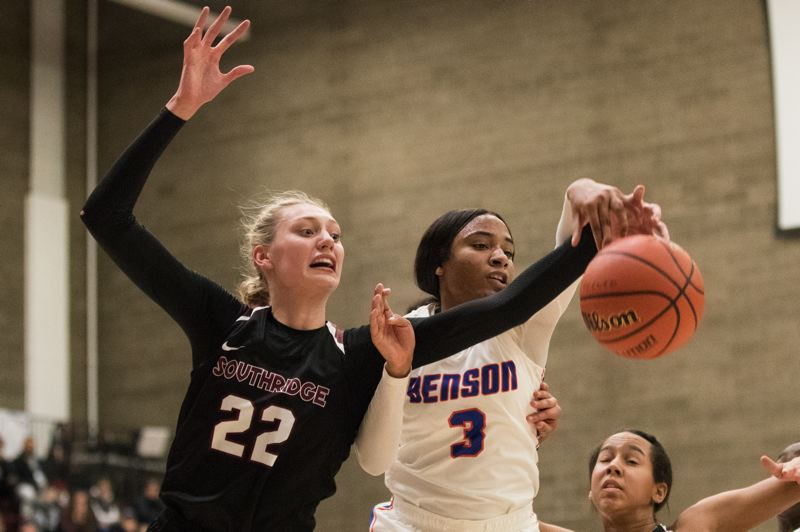 TRIBUNE PHOTO: JAIME VALDEZ - Cameron Brink (left) of Southridge High and Ciera Ellington of Benson battle for the ball during their teams' game Saturday in the Pacific Office Automation Holiday Classic at Franklin High. Southridge won 55-50 in the final of their division.