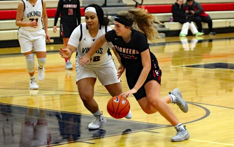 PAMPLIN MEDIA: JIM BESEDA - Oregon City's Katie Kathan (right) drives past Inglemoor's Eva Taylor during the second half of Saturday's championship final at the Nike Interstate Shootout at Lake Oswego High School.