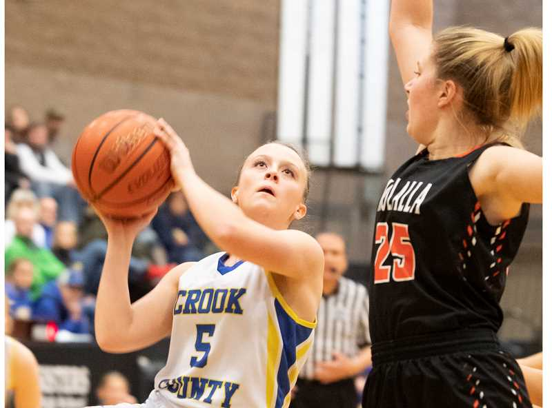 LON AUSTIN/CENTRAL OREGONIAN - Teagan Freeman goes strong to the basket against Molalla on Thursday. Freeman scored 11 points to lead the Cowgirls in scoring, but Molalla won by 18.