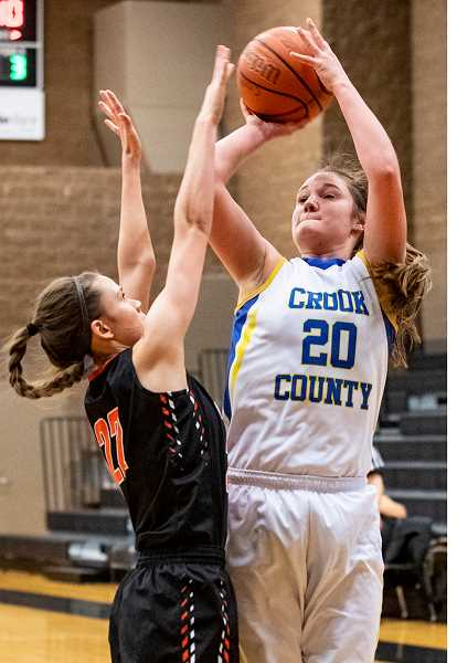 LON AUSTIN/CENTRAL OREGONIAN - Liz Barker goes up for two points in the first quarter of the Cowgirls' loss to Molalla. Crook County struggled to a 0-3 record at the Sisters Holiday Tournament.