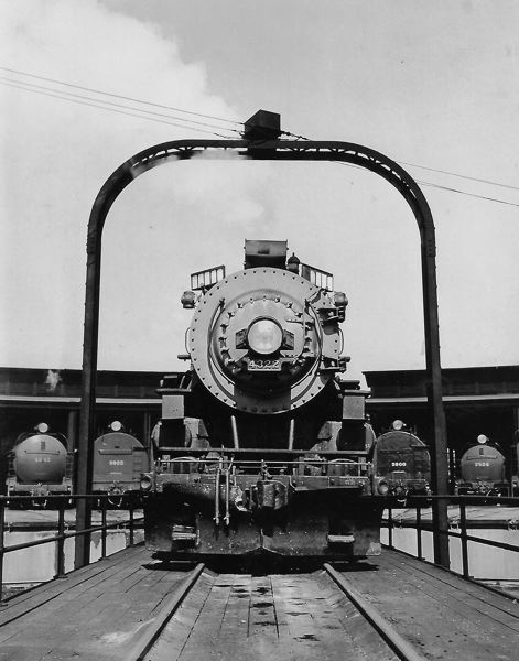 COURTESY ED AUSTIN COLLECTION - Steam locomotive Southern Pacific 4322 poses on the turntable at Union Pacific Brooklyn Yard. The Brooklyn Roundhouse can be seen in the background. Photo from Ed Austin Collection'