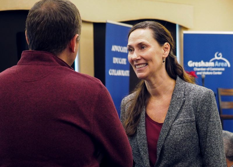 CONTRIBUTED PHOTO: MT. HOOD COMMUNITY COLLEGE - Skari chats with a community member at a recent Gresham Area Chamber of Commerce meeting.