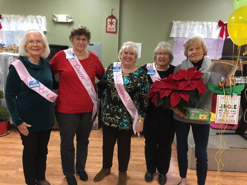 RSVP PHOTO - Donna Baker, far right, is honored as RSVPs volunteer of the month for December. Baker was recognized for volunteering at the Scappoose Senior Center, arriving early each morning so seniors can come enjoy a game of pool. She makes the coffee, lays out the silverware and gets everything ready for the day, says Julie Stephens, manager at the Senior Center. Baker was joined by My Fair Lady court members Jeanne Kangas, MFL Queen Carla Bodenhamer, Mary Ann Shaw, and Sharon Brown.
