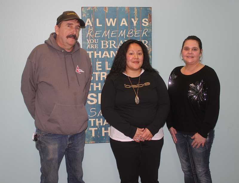 SUSAN MATHENY/MADRAS PIONEER - Turning Points staff includes Roger Smith, clinical supervisor, Orie Made, recovery mentor, and Markell Petersen, at right, clinical supervisor assistant.
