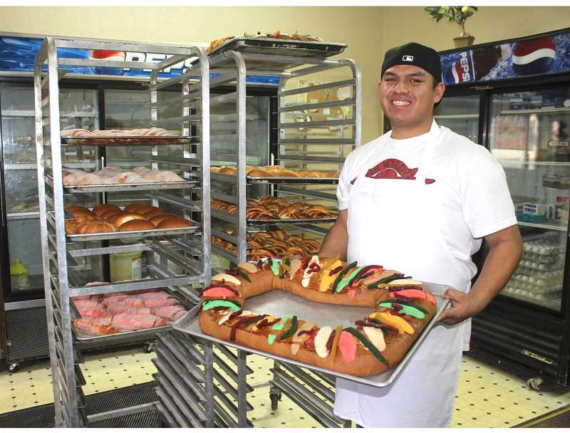 SUSAN MATHENY/MADRAS PIONEER - Baker Jesus Vazquez shows a 'Ring of Kings' cake at the family-run Panaderia Las Cuatas in Madras.
