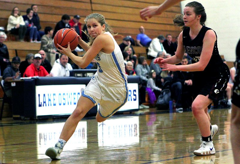 REVIEW PHOTO: MILES VANCE - Lakeridge freshman guard Reese Ericson drives to the basket during her team's 52-49 win over Glencoe in the first round of the Nike Interstate Shootout at Lake Oswego High School on Dec. 26.