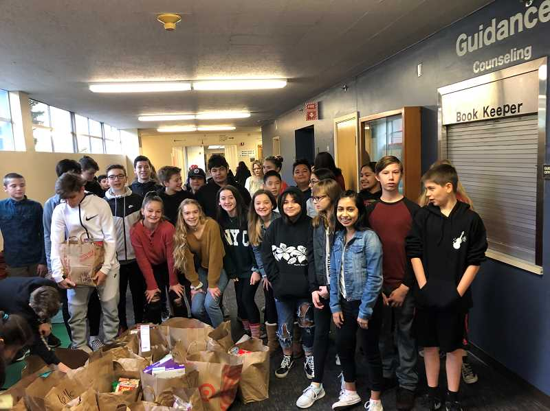 COURTESY OF KAREN JOHNSON - Over the holiday season, eighth-graders at Twality Middle School collected 7,255 of food, the most ever, for those in need.