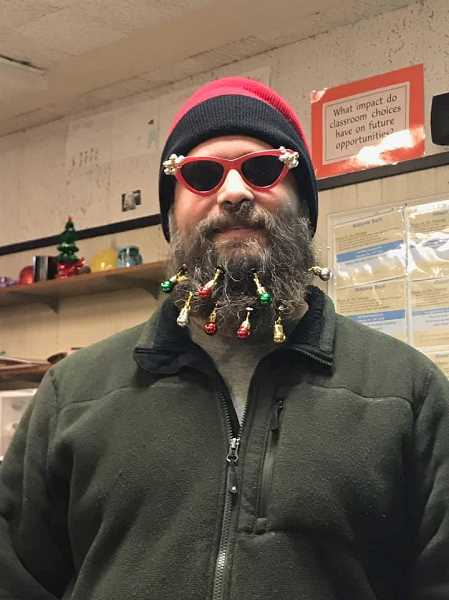 COURTESY OF KAREN JOHNSON - Chad Clark, an eighth-grade teacher at Twality Middle School, wears ornaments in a beard he plans on shaving after students went well over a goal of collecting 1,000 pounds of food during the holidays.
