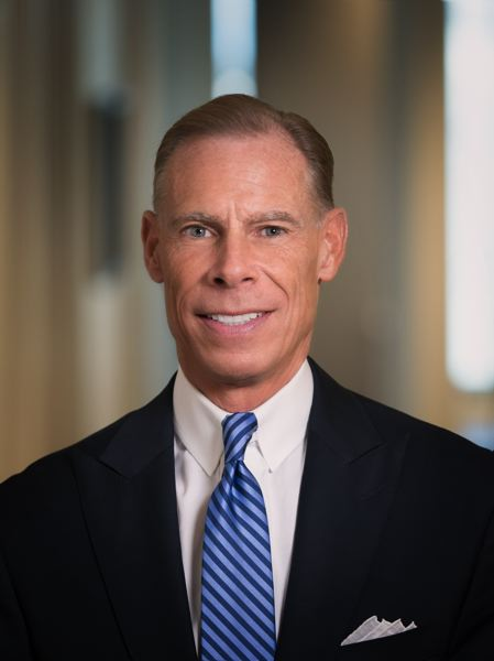 SUBMITTED PHOTOS - George W. Hosfield, director and chief investment officer for Ferguson Wellman Capital Management, gives the Fed a thumbs up for normalizing interest rates and keeping markets calm.