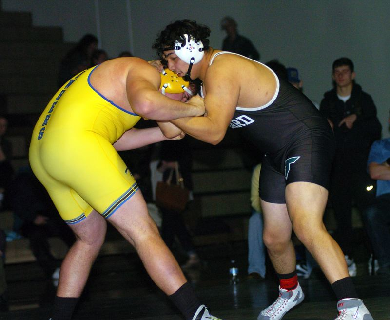 TIMES FILE PHOTO - Tigard High School senior Javier Velasquez (right) won the tournament title at 285 pounds at the Pacific Coast Wrestling Championships.