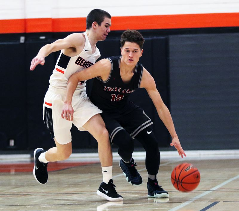 TIMES PHOTO: DAN BROOD - Tualatin junior guard Sam Noland (right) looks to get past Beaverton senior Isaac Rosenthal during Fridays non-league game.