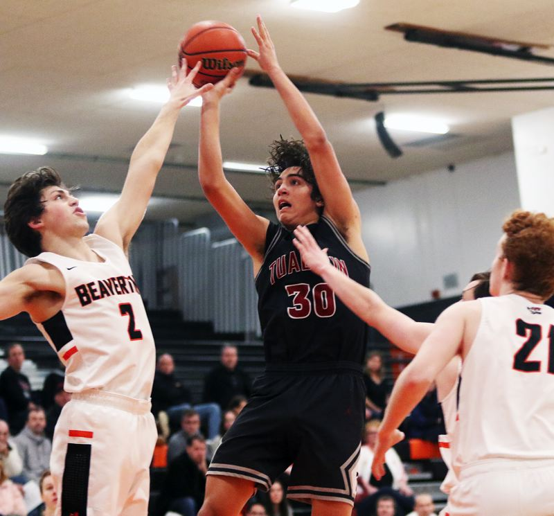 TIMES PHOTO: DAN BROOD - Tualatin senior post Bridger Steppe (30) takes a shot during the Wolves' win at Beaverton on Friday.
