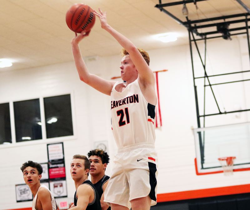 TIMES PHOTO: DAN BROOD - Beaverton junior John Oleson takes a jump shot during the Beavers' game with Tualatin on Friday.