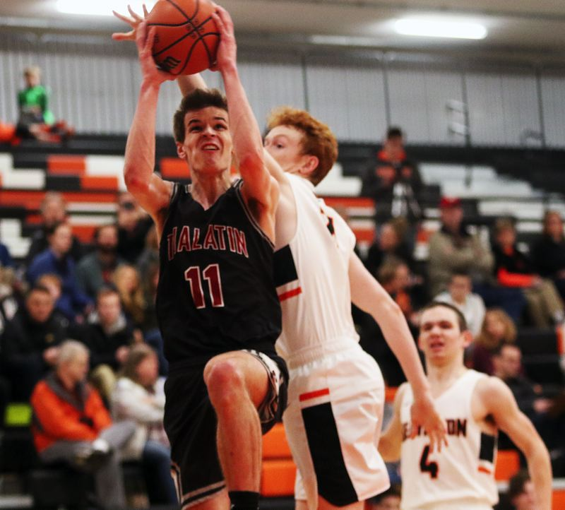 TIMES PHOTO: DAN BROOD - Tualatin senior Jason Wisler goes up to the basket during the Wolves' win at Beaverton.