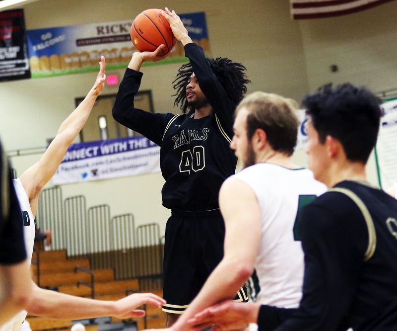 TIMES PHOTO: DAN BROOD - Southridge senior Brock Henry puts up a jump shot during the Skyhawks game with Tigard on Friday at the Les Schwab Invitational.