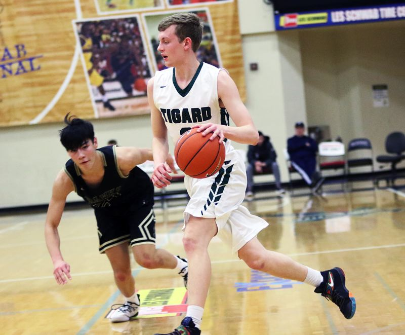 TIMES PHOTO: DAN BROOD - Tigard senior Jake Bullard controls the ball during the Tigers' win over Southridge at the Les Schwab Invitational.