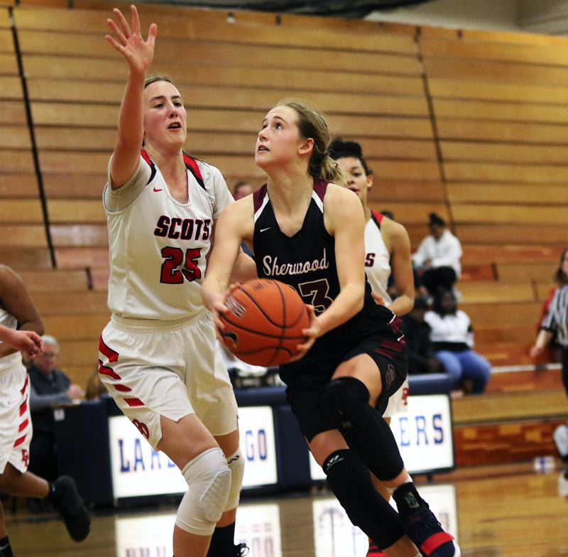 TIMES PHOTO: DAN BROOD - Sherwood sophomore Joley Sproul (right) looks to go up to the basket against David Douglas junior Paige Collins during play at the Nike Interstate Shootout.