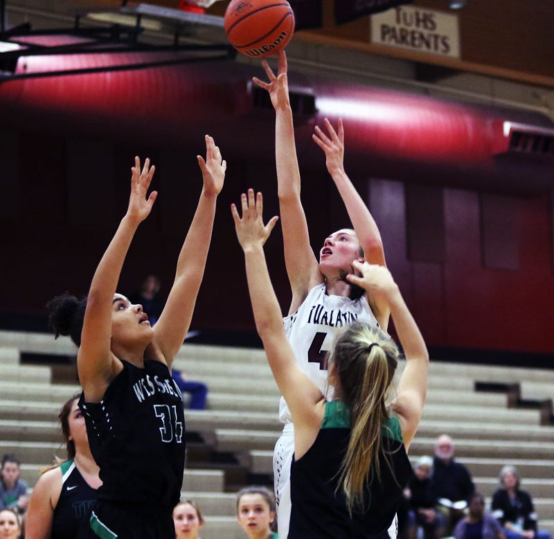 TIMES PHOTO: DAN BROOD - Tualatin sophomore post Natalie Lathrop shoots over West Salem junior Daphne Moskal during last weeks game. Lathrop scored 20 points in the contest.