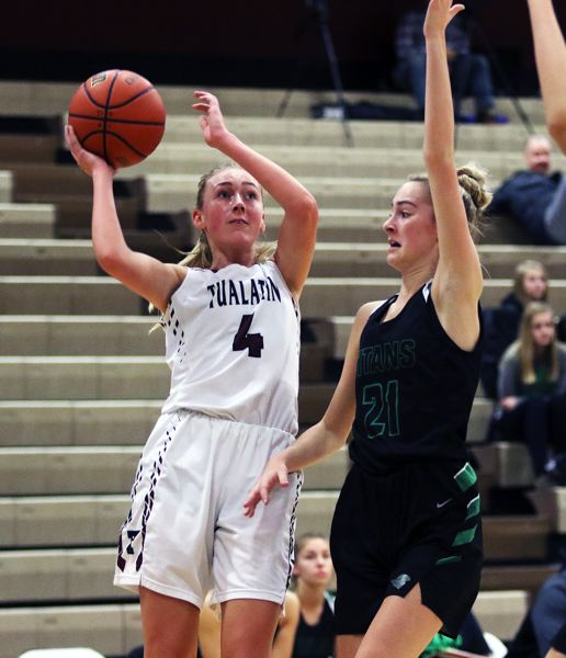 TIMES PHOTO: DAN BROOD - Tualatin senior Natali Denning (left) looks to go up to the basket against West Salem junior Maddie Bertsch during last weeks game.