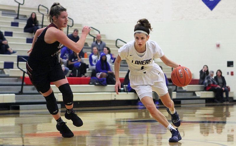 REVIEW PHOTO: MILES VANCE - Lake Oswego senior Taylor Anders looks for room to operate during her teams loss to Sherwood in the Nike Interstate Shootout at Lake Oswego High School on Dec. 28.
