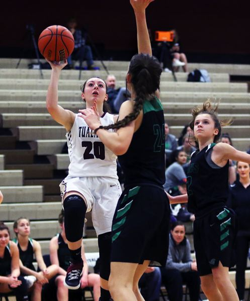 TIMES PHOTO: DAN BROOD - Tualatin senior Kassidy Lewis (20) looks to shoot over West Salem sophomre Austynn Covill during last weeks game.