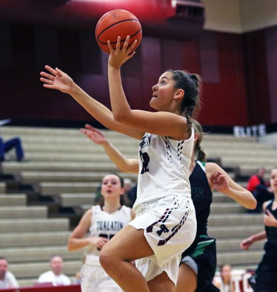 TIMES PHOTO: DAN BROOD - Tualatin sophomore Sidney Dering goes up to the basket during the Wolves game with West Salem at the Elite 8 Invitational.