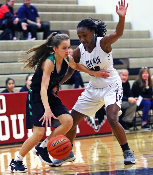 TIMES PHOTO: DAN BROODT - Tualatin senior Maliyah Ross (right) puts tight full-court pressure on West Salem sophomore Maddie Allstock during last weeks game.