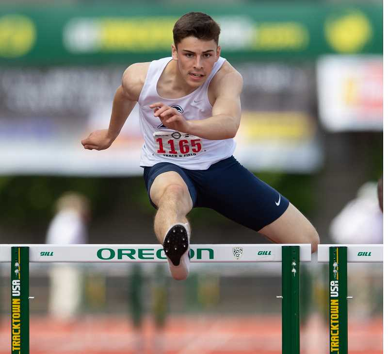 STAFF PHOTO: CHRISTOPHER OERTELL - Liberty's Aiden Maloney competing during the state track and field meet in Eugene. Maloney placed in four events in the meet.