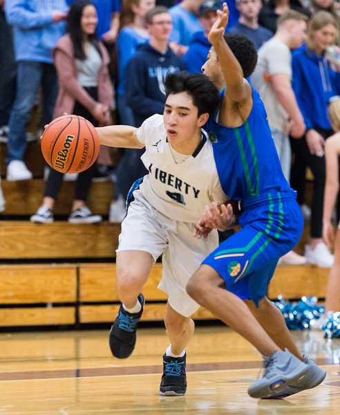 STAFF PHOTO: CHRISTOPHER OERTELL - Liberty's Nathanael Boyer during a game against Aloha last season. Boyer scored 40 points in the Falcons' play-in game against Benson.