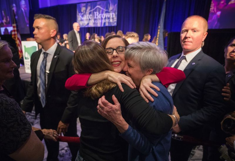 TIMES PHOTO: JONATHAN HOUSE - Gov. Kate Brown hugs supporters on election night in November, after voters granted her four more years in the governor's chair.