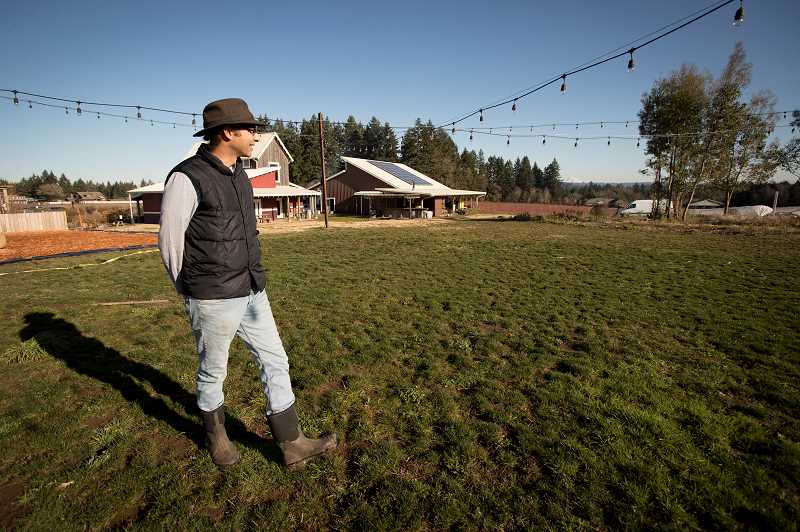 TIMES PHOTO: JAIME VALDEZ - Narendra Varma surveys the property where Our Table Cooperative store and farm has been operating for the last five years.