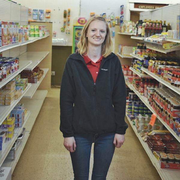ESTACADA NEWS PHOTO: EMILY LINDSTRAND - Felicia Malkson stands in a recently reorganized aisle at Real Deal Grocery. Her family purchased the discount store last fall.