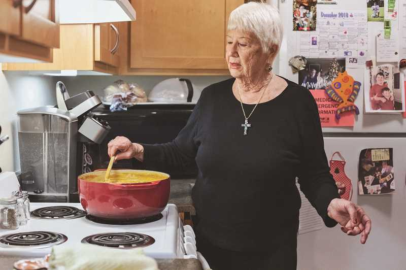 SPOKESMAN PHOTO: JONATHAN HOUSE - Jean Hornsby prepares a helping of chicken and vegetable soup that she delivers to her friends.
