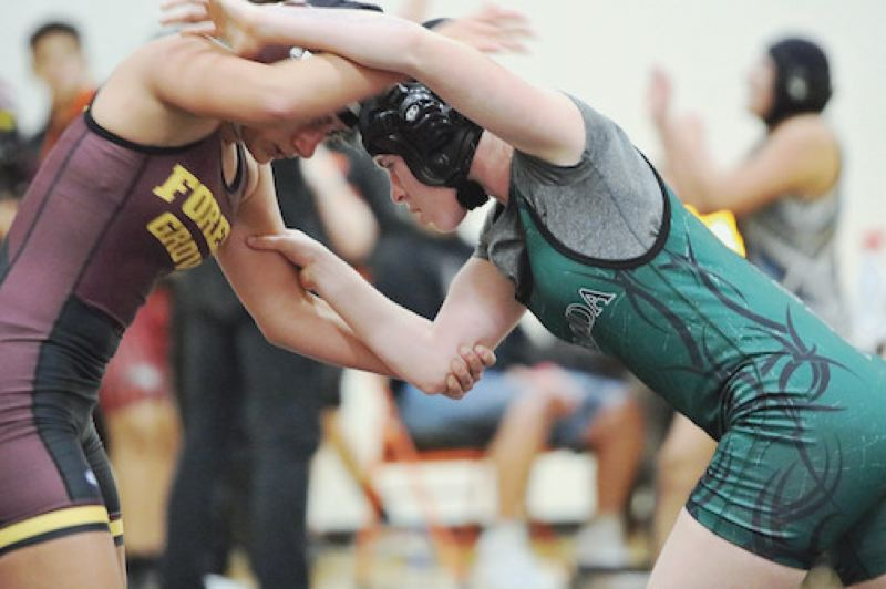 PAMPLIN MEDIA: JIM BESEDA - Dana Glasser works to stay in the top position on her way to a 4-2 decision over Forest Groves Hailey Peterson during a Gladstone tournament.