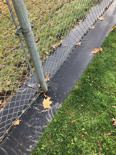 SPOKESMAN FILE PHOTO  - The WL-WV School District is testing equipment along fence lines that covers the base of any fence to prevent weeds from growing.