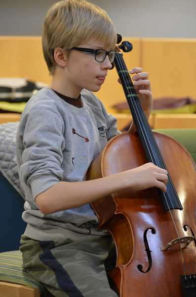 SPOKESMAN PHOTO: VERN UYETAKE - Oliver Svadlenka concentrates during strings orchestra rehearsal at Boeckman Creek Primary last winter.