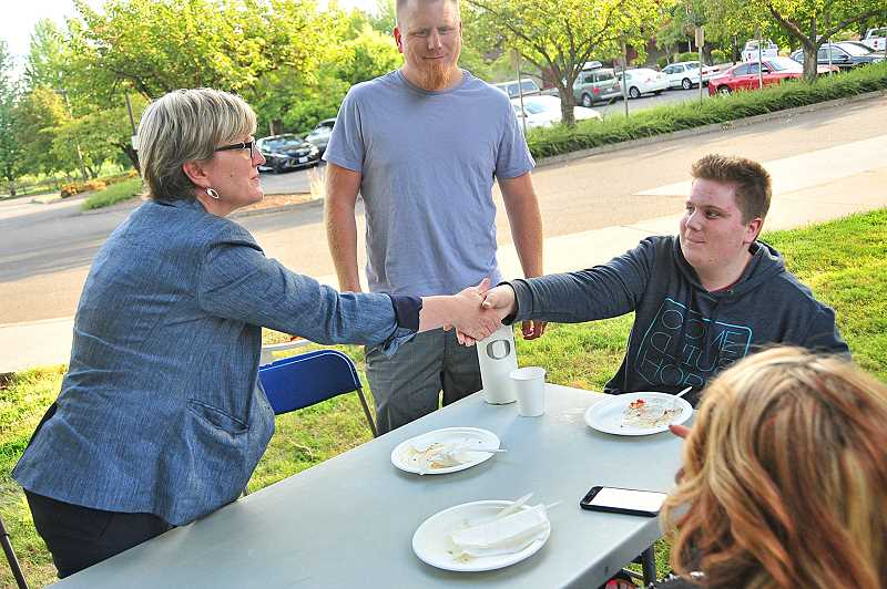 SPOKESMAN PHOTO: VERN UYETAKE - Superintendent Kathy Ludwig welcomes junior Dylan Carter back to Art Tech High School after summer break.