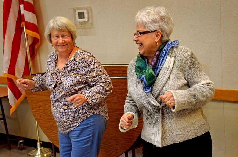 SPOKESMAN PHOTO VERN UYETAKE - Guests at the Wilsonville Community Center, Donna Hammersly (left), and Carman McNish, cant fight the feeling as they dance during a January Book Notes Concert sponsored by the Wilsonville Library.