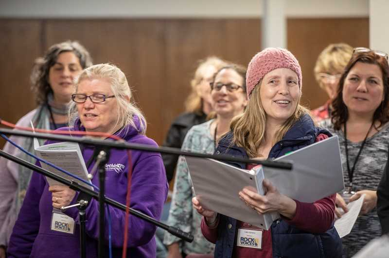 REVIEW PHOTO: JONATHAN HOUSE - Caley Barstow (right) and Ginia Finch sing 'Suddenly I See' during a recent Rock Voices rehearsal.