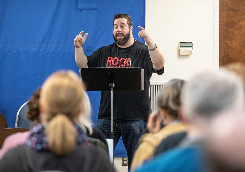 REVIEW PHOTO: JONATHAN HOUSE - Director Mark Barstow leads the Rock Voices chorus during a recent rehearsal in Portland.