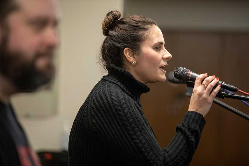 REVIEW PHOTO: JONATHAN HOUSE - Soraya Stelle performs a solo during a recent rehearsal with the Rock Voices chorus.