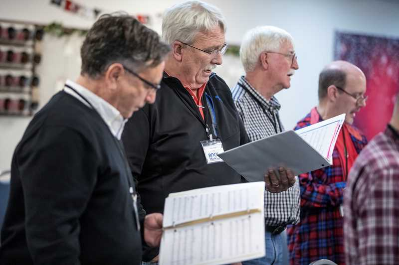 REVIEW PHOTO: JONATHAN HOUSE - Steve Wells (second from left) sings 'Suddenly I See' with fellow chorus members during a recent Rock Voices rehearsal.