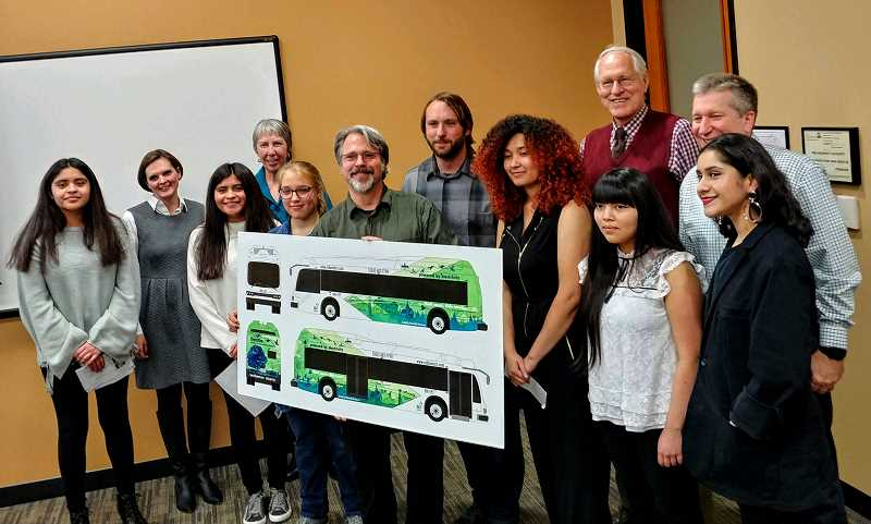 SUBMITTED PHOTO  - WHS art students, WHS art teacher Christopher Shotola-Hardt and Art Tech teacher Philip Clark presented the bus design to the City Council in December.