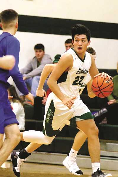 JO WHEAT - North Marion junior Sergio Jimenez went off for 40 points, 10 rebounds and four assists in the Huskies' 95-82 victory over the Woodburn Bulldogs in the championship game of the Abby's Pizza Holiday Classic.