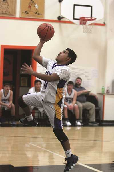 PHIL HAWKINS - Gervais sophomore Damian Tavera goes up for a fast break layup attempt in the Cougars' 60-33 loss to Willamina on Thursday. Tavera led the team with 13 points, including four 3-pointers.