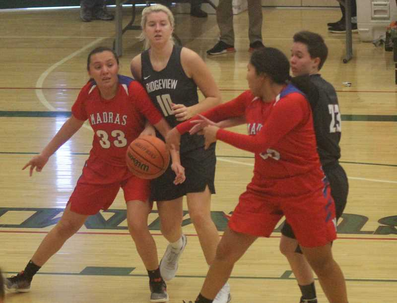 STEELE HAUGEN - Jiana Smith-Francis pass the ball to post player DaRia White.