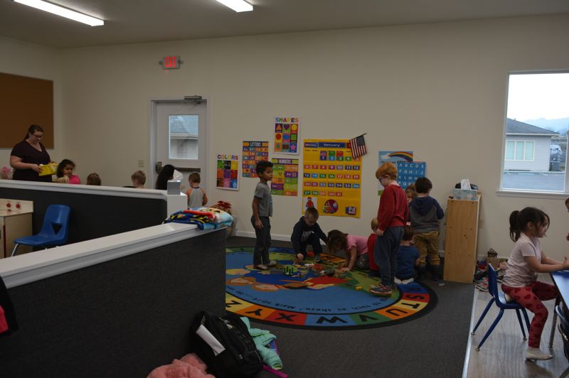 SPOTLIGHT PHOTO: COURTNEY VAUGHN - Children gather around a corner of the new daycare room at Grace Lutheran Churchs childrens center in Scappoose.  A childrens wing of the building was recently rebuilt after a kitchen fire at the site back in June.