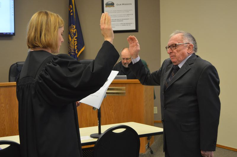 SPOTLIGHT PHOTO: NICOLE THILL-PACHECO - Steve Topaz, right, recites the oath of office as he is sworn in to the St. Helens City Council by Muncipal Court Judge Amy Lindgren on Wednesday, Jan. 2. Topaz will now serve a four-term in Position 3 on the City Council.