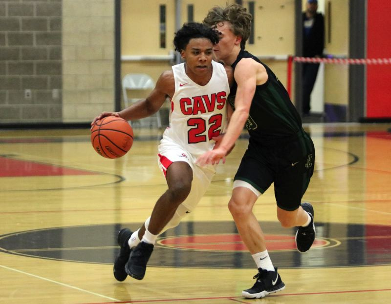 PAMPLIN MEDIA: JIM BESEDA - Clackamas' Jailen Hammer drives on Jesuit's Matthew Levis during the first half of Wednesday's non-conference boys' basketball game at Clackamas. Jesuit won 79-58.