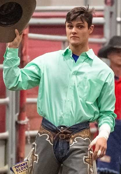 LON AUSTIN/CENTRAL OREGONIAN - Dougherty doffs his hat to the crowd as he is introduced at the Buckin' for Rowdy event.